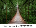 Stock photo suspension bridge crossing the river ferriage in the woods 227275720