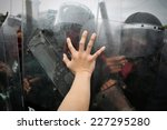 protester pushes police riot...   Shutterstock . vector #227295280