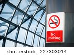 no smoking board   sign in the... | Shutterstock . vector #227303014