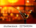 glass with martini   focus on a ... | Shutterstock . vector #227349394
