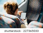 woman reading book on the train ... | Shutterstock . vector #227365033
