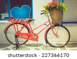 vintage red bicycle with flower ...   Shutterstock . vector #227366170