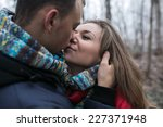 couple in winter forest near... | Shutterstock . vector #227371948