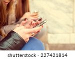 girls typing on mobile phones  ... | Shutterstock . vector #227421814