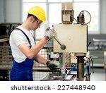 worker on drill machine | Shutterstock . vector #227448940
