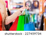 woman with shopping bags in shop | Shutterstock . vector #227459734
