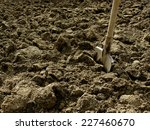 shovel in the ploughed ground   Shutterstock . vector #227460670