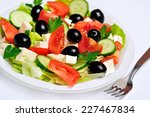 plate with vegetable salad on... | Shutterstock . vector #227467834