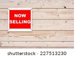 now selling red white sign on... | Shutterstock . vector #227513230