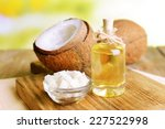 Coconut Oil On Table On Light...