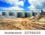 A Row Of Granaries Against The...