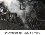 Steam locomotive rolling by close - stock photo
