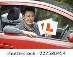 smiling teenage boy in car... | Shutterstock . vector #227580454