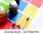 bottle of ink printer has three ... | Shutterstock . vector #227586934