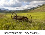Ancient Plow In A Prairie With...