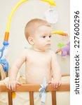 baby boy waving hand and... | Shutterstock . vector #227600296