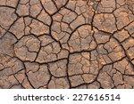 cracks in the ground background | Shutterstock . vector #227616514