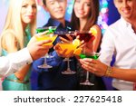 young people dancing at party  | Shutterstock . vector #227625418