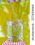 glass of water on nature... | Shutterstock . vector #227654464