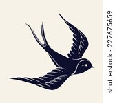 Stock vector vector ink pen hand drawn flying swallow silhouette illustration with vintage feel flying swallow 227675659