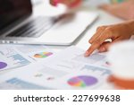 two women working together at...   Shutterstock . vector #227699638