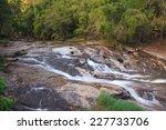 water fall scene in green... | Shutterstock . vector #227733706