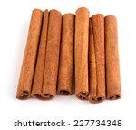 cinnamon isolated on white... | Shutterstock . vector #227734348