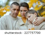 sad family of three on the... | Shutterstock . vector #227757700