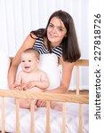 portrait of beautiful mother... | Shutterstock . vector #227818726