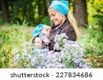 baby sucks milk from the breast ... | Shutterstock . vector #227834686
