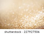 Christmas Background. Golden Holiday glowing Abstract Glitter Defocused Background With Blinking Stars. Blurred Bokeh  - stock photo