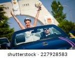 beautiful wedding couple in car  | Shutterstock . vector #227928583