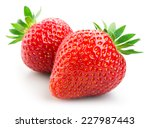 two strawberries isolated on... | Shutterstock . vector #227987443