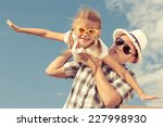 dad and daughter playing near a ... | Shutterstock . vector #227998930