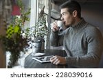 handsome man drinking coffee... | Shutterstock . vector #228039016