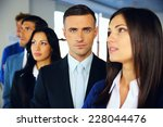 group of a young serious... | Shutterstock . vector #228044476