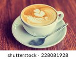 Small photo of Coffee cup in coffee shop - vintage style effect picture