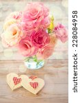 Love Vintage Background - Beautiful Eustoma  Flowers and Two Hearts, light defocused - stock photo