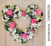 Heart Flower Wreath Over Light...