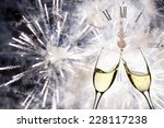 glasses with champagne against... | Shutterstock . vector #228117238