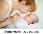 portrait of happy mother and... | Shutterstock . vector #228150628