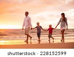 happy young family of four on... | Shutterstock . vector #228152599
