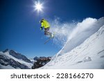 skier in high mountains during... | Shutterstock . vector #228166270