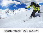 Skier In High Mountains During...