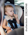 happy toddler boy in the car... | Shutterstock . vector #228224968