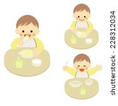 smiling baby eating food  ... | Shutterstock .eps vector #228312034