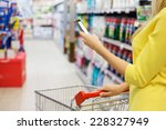 woman checking shopping list on ... | Shutterstock . vector #228327949