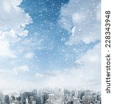 snow falling down over the city | Shutterstock . vector #228343948