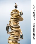 Small photo of Business figurines on top of invested money
