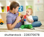 happy family dad and son play... | Shutterstock . vector #228370078